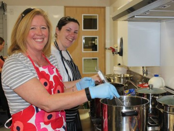 Volunteers: Jo Weston (front) & Amy King (back) taking part in Bellyfull's first Cookathon - striving to feed Selwyn.
