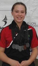 Ella Benn with her medals at the NZ Short Course Champs.