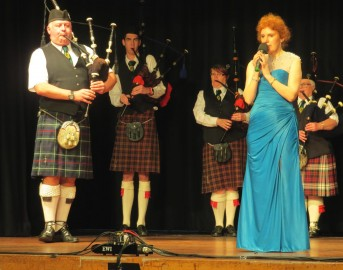 Organiser and Performer June Burney with the Ellesmere Pipe Band.