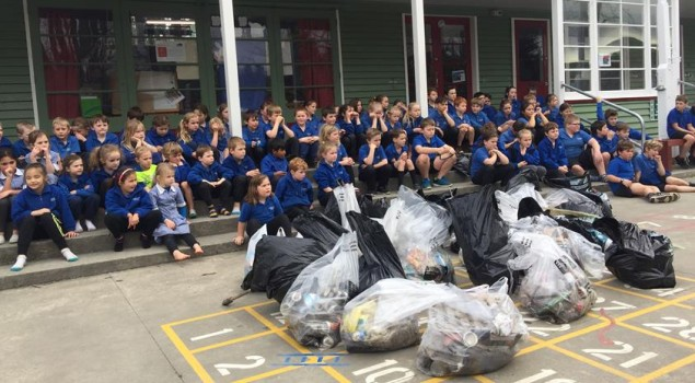 Students from Glentunnel School look at the numerous bags of rubbish they collected during their clean up.