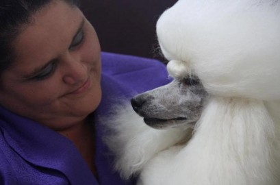 Best of friends Emma Case-Peters  (left) with Monty the prize-winning poodle.