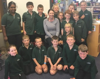 New principal, Bronwen Seaward, at Windwhistle School with Room 2, (years 4-6) her class for the year. Back L to R:  Abhisha, Tahu, Max, Alex, AMelia, Walter, Emily, Jesse, Emma.  Front L to R: Martha, Jed, Connor, Daniel, Kate, Fergus, James.