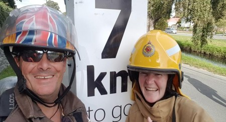 Firefighters, Philip Hunt (left) and Sarah Collins at the halfway mark in the City2Surf.