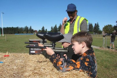 Ollie Loos with the paint ball gun with Guy Abraham who helped run the 'Shoot the Turkey' event which proved to be very popular with the kids.