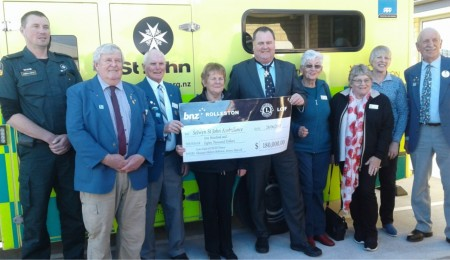 President Shirley McNicholl and members of the Rolleston Lions' Club presenting John Sunckell Chairman of Selwyn St John with  a $180,000 cheque for the purchase of a new Ambulance for Rolleston, at a ceremony on June 28th.